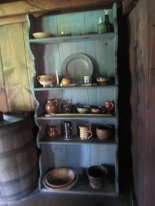 Rebecca Towne Nurse Homestead, a shelf in kitchen showing typical ceramic and metal articles.