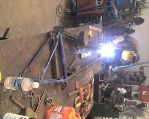 "Building art bike ""Big Red"" Welding stell tubing to bicycle frame parts"